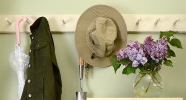 mudroom in a home with umbrellas and flowers