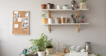 kitchen wall with shelves and corkboard