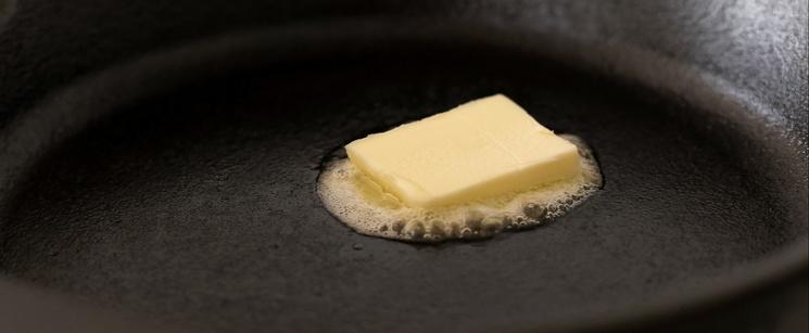 Pat of Butter Melting on a Skillet