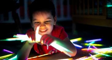 boy playing with glow sticks