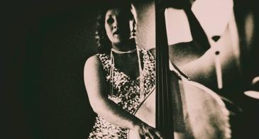 woman playing bass