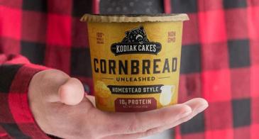 Man in Buffalo Check Flannel Holds Kodiak Cakes Cornbread