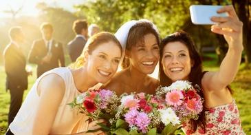 bridesmaids and bride taking selfie