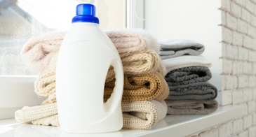 laundry detergent bottle and towels