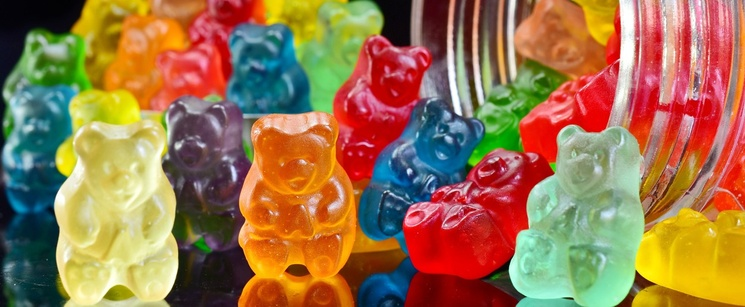 Gummy bears falling out of a jar