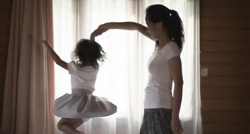 mom and daughter dancing