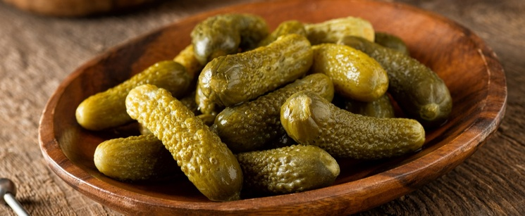 Bowls of small uncut pickles