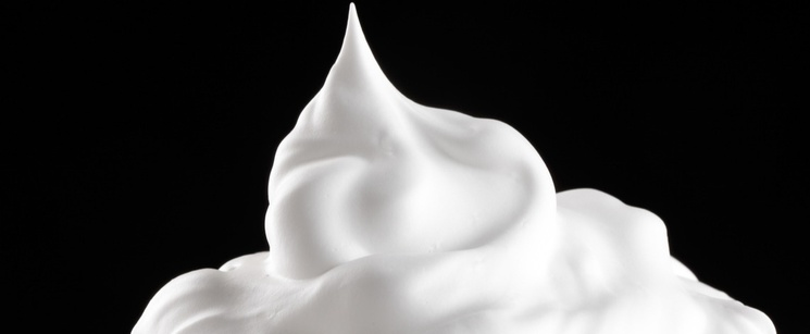 Whipped cream with black background