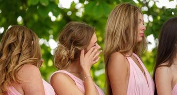 bridesmaid wiping a tear