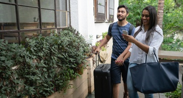 couple arriving at home